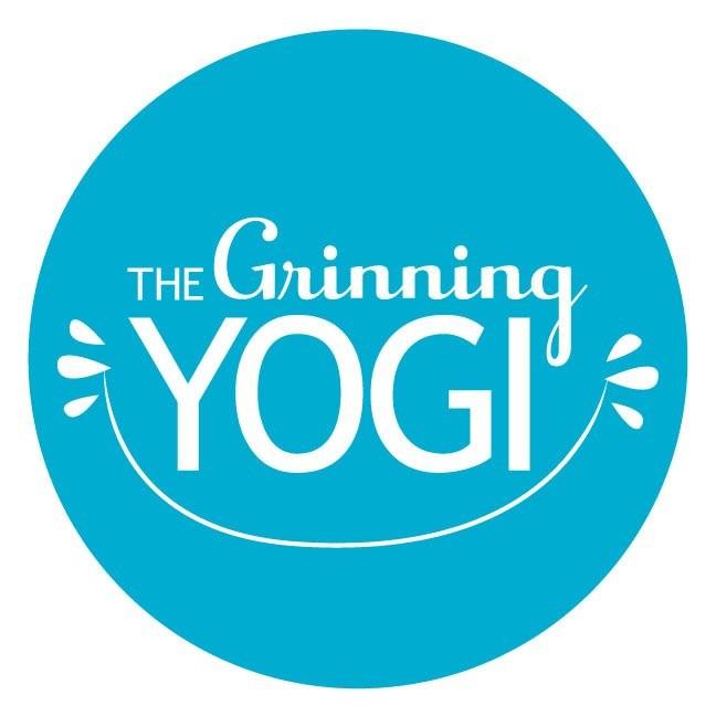 The Grinning Yogi logo